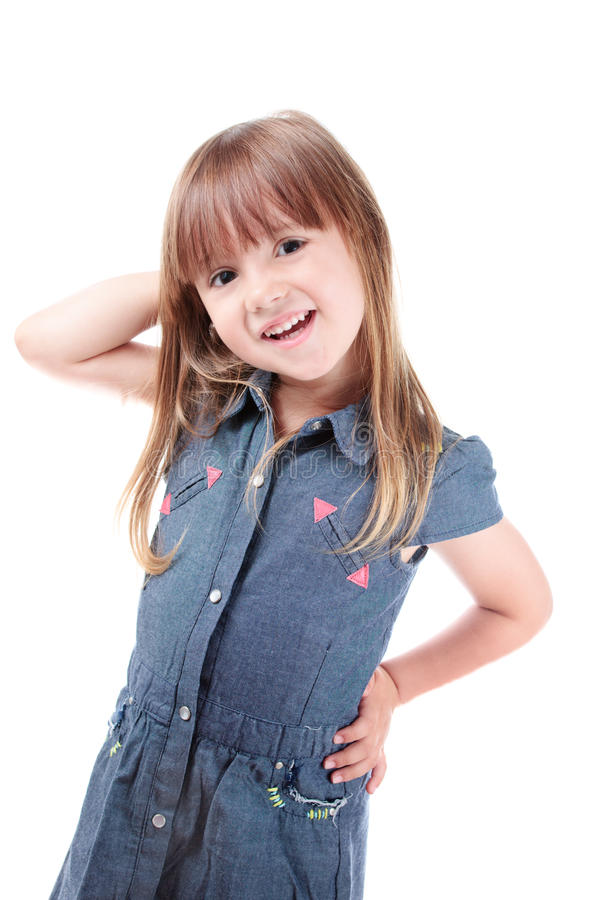 Little model. Lovely little girl posing like a fashion model royalty free stock photography