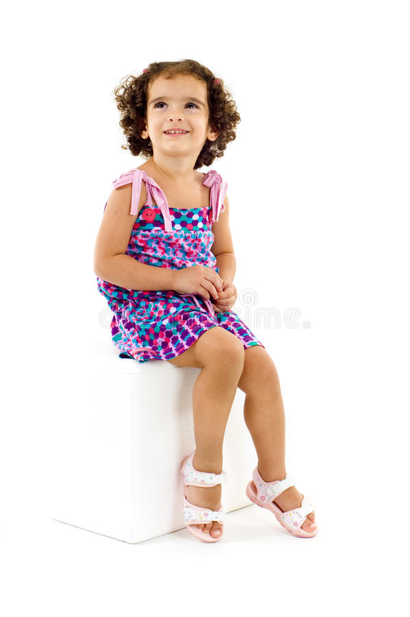 Little Model. Cute little and happy girl sitting royalty free stock photo
