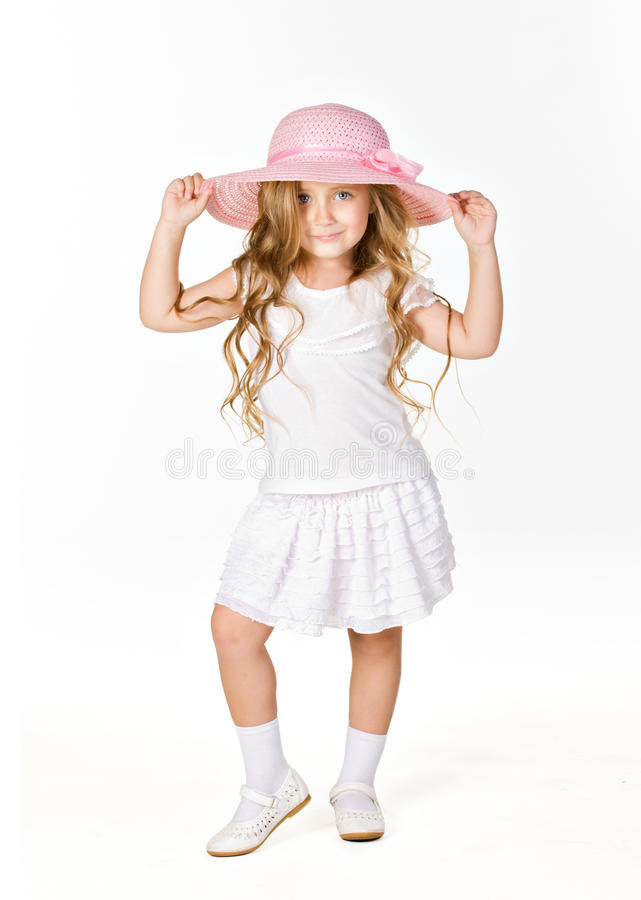 Little model. Beautiful little model in white cloth and pink had isolated on white royalty free stock photography