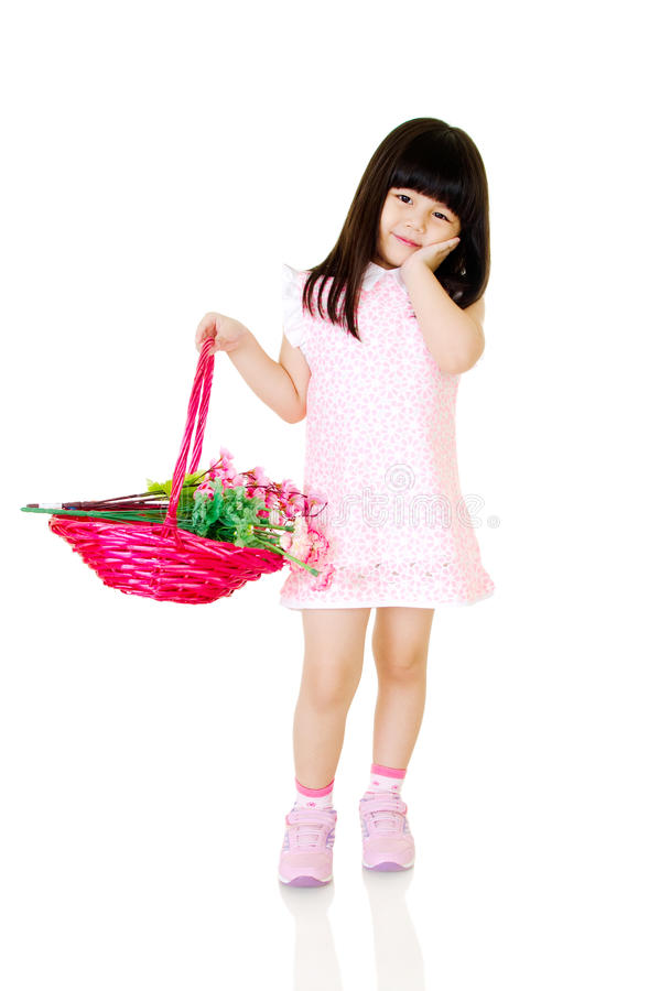 Little model. Little asian girl holding a basket of flower royalty free stock photography