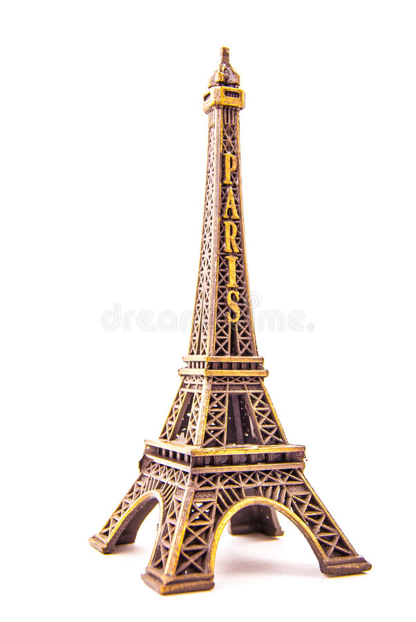 Little model of Eiffel Tower. Photo of little model of Eiffel Tower isolated on white. Image of travel in France and symbol of Paris stock images