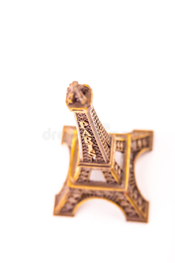 Little model of Eiffel Tower. Photo of little model of Eiffel Tower isolated on white. Image of travel in France and symbol of Paris stock photos