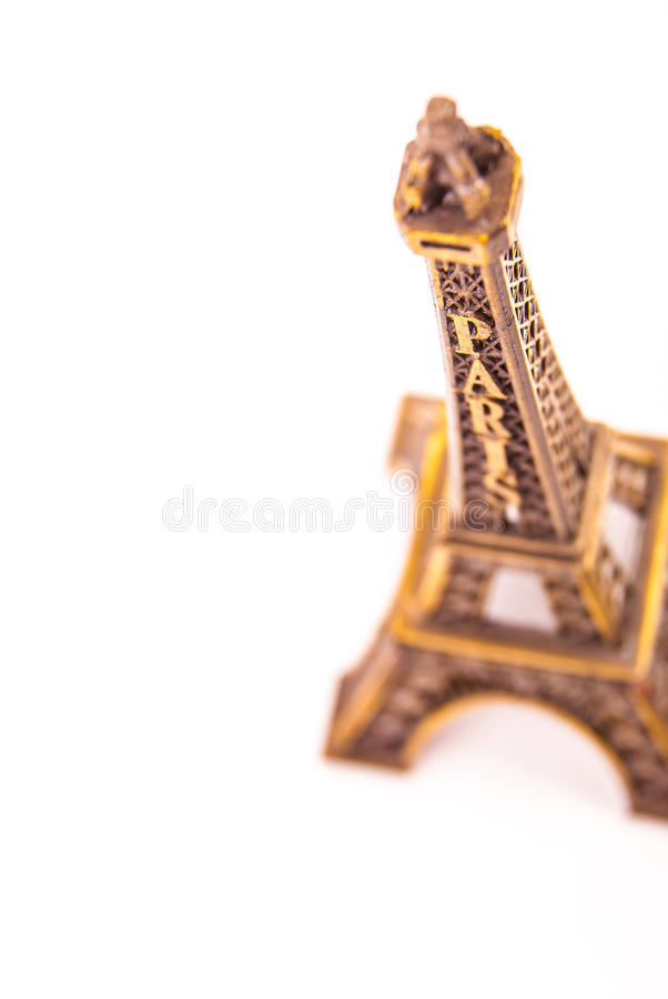 Little model of Eiffel Tower. Photo of little model of Eiffel Tower on white. Image of travel in France and symbol of Paris stock photo