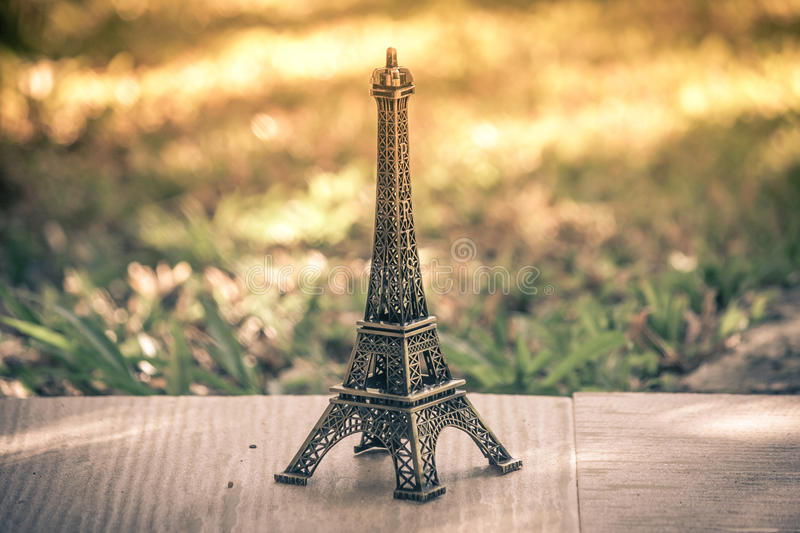 Little model of Eiffel tower. Little model of Eiffel tower with vintage effect royalty free stock photos