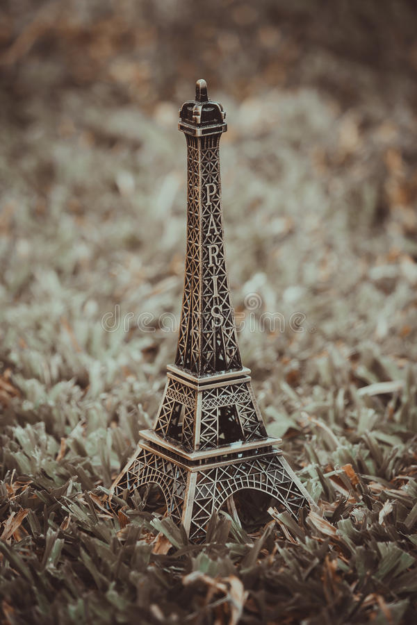Little model of Eiffel tower. Little model of Eiffel tower with vintage effect royalty free stock images