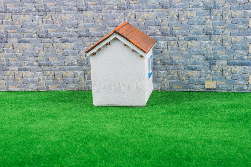 Little model house on grass royalty free stock photography