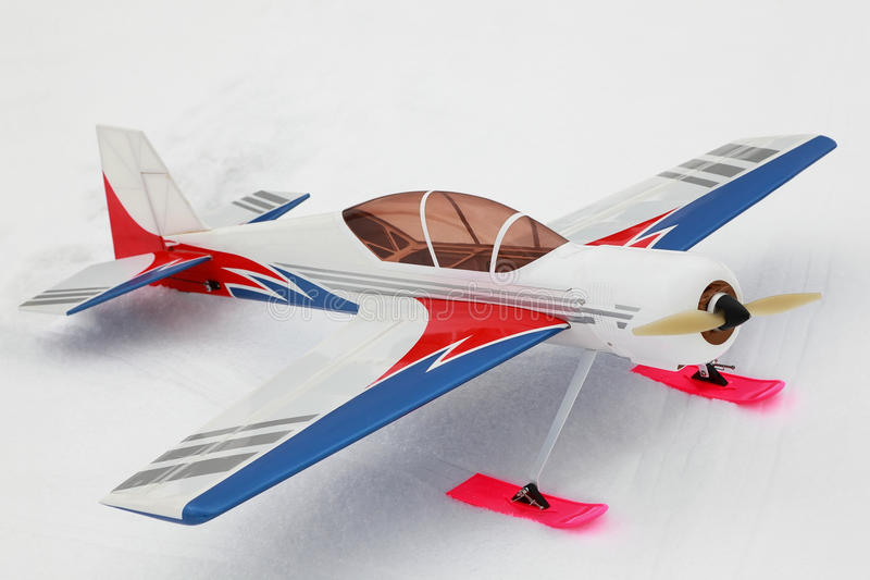 Little model of radio-controlled airplane stands. On to snow royalty free stock image