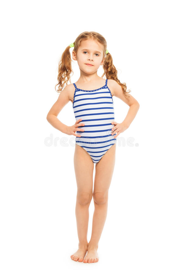 Little model in stripped swimming suit. Little model standing full length in stripped swimming suit isolated on white stock photography