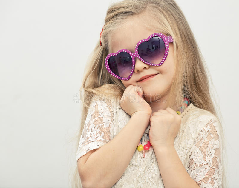 Little model with sunglasses . Isolated portrait royalty free stock image