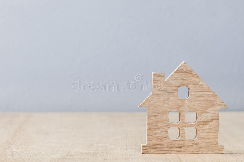 Little model toy symbol of house on wood background royalty free stock image
