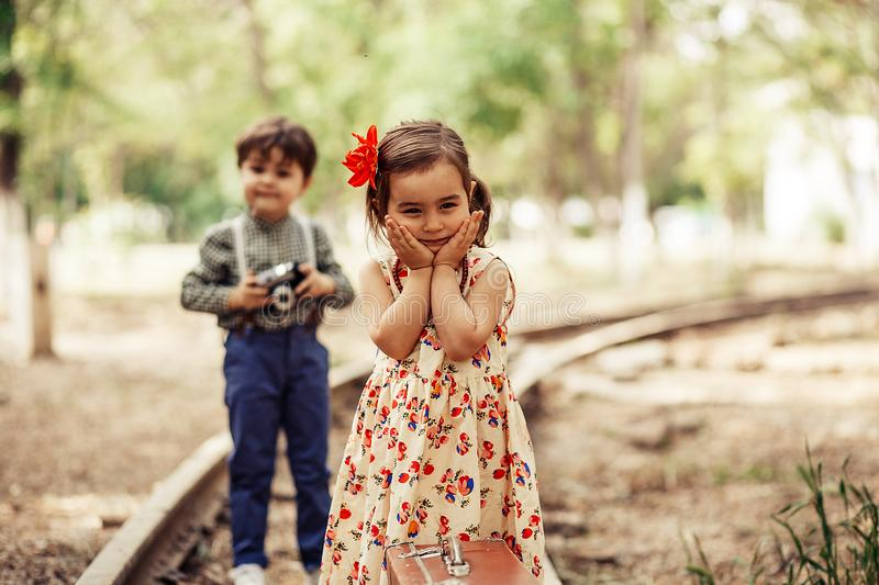 Little model in vintage dress posing for little photographer royalty free stock photography
