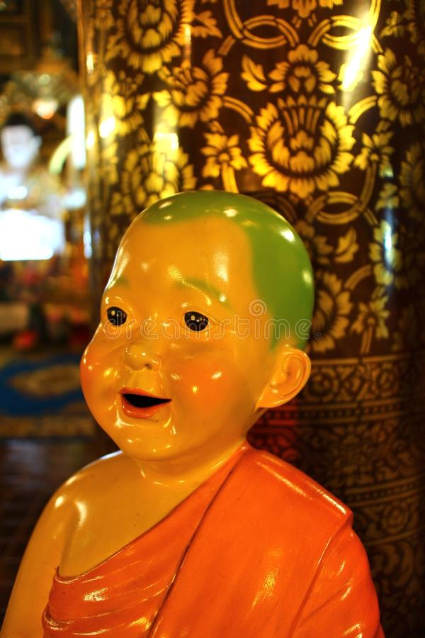 The Little monk doll in wat inthakin temple at chiang mai Thailand stock photography