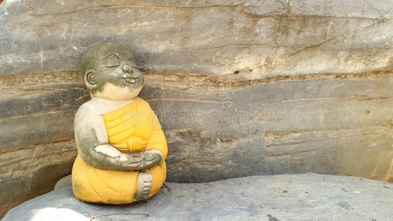 Little monk meditation background royalty free stock image