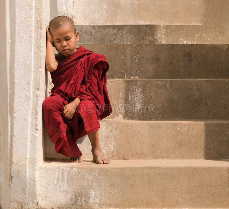 Little monk stay in pagoda Mandalay,Myanmar. Little monk or novice monk sitting in pagoda mandalay myanmar. stock photo