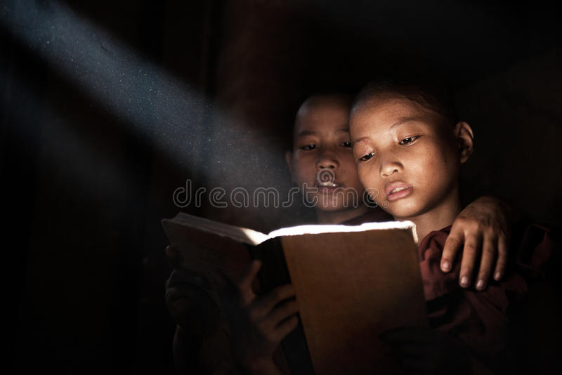 Little monks reading book royalty free stock photo