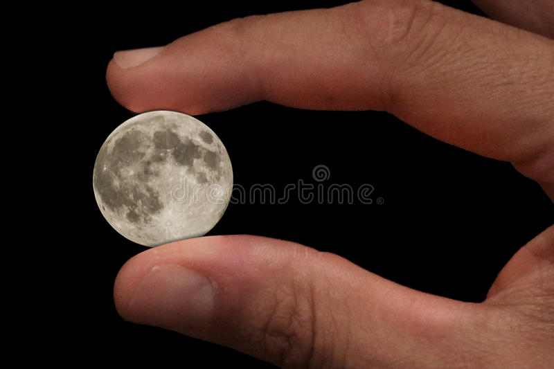 Little moon. In the hand, photocomposition with photoshop stock image