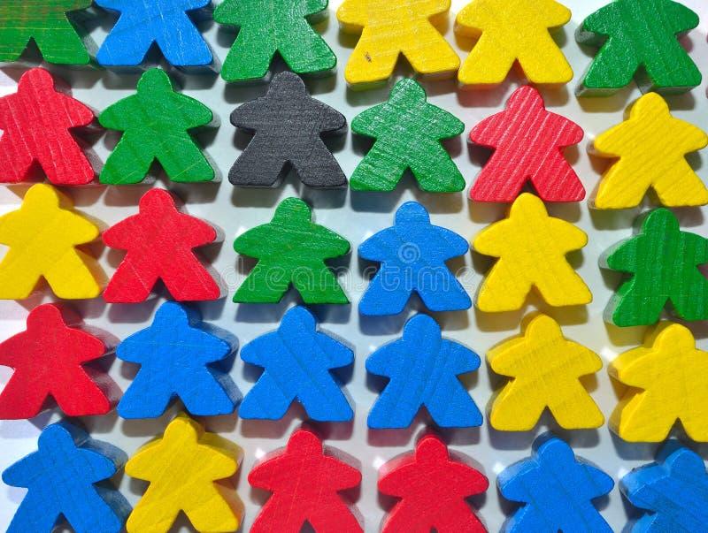 Little multi colour wooden human figures stock images