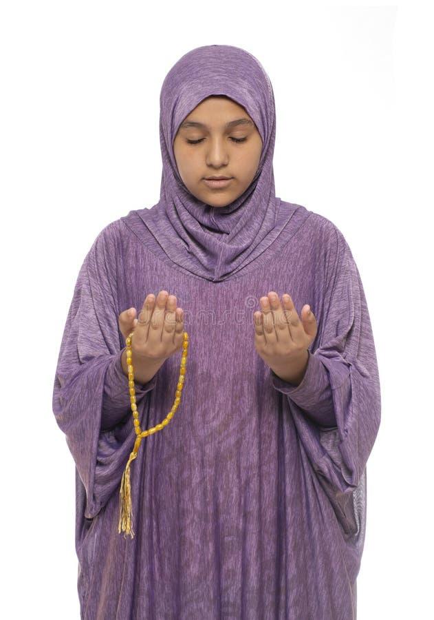 Free Little Muslim Female Praying For Allah With Prayer Costume, Ramadan Kareem Concept Royalty Free Stock Images - 214641529