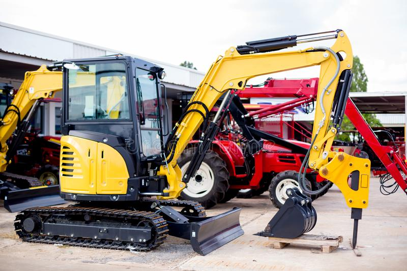 Little New Yellow Excavator on Tracks stock photo