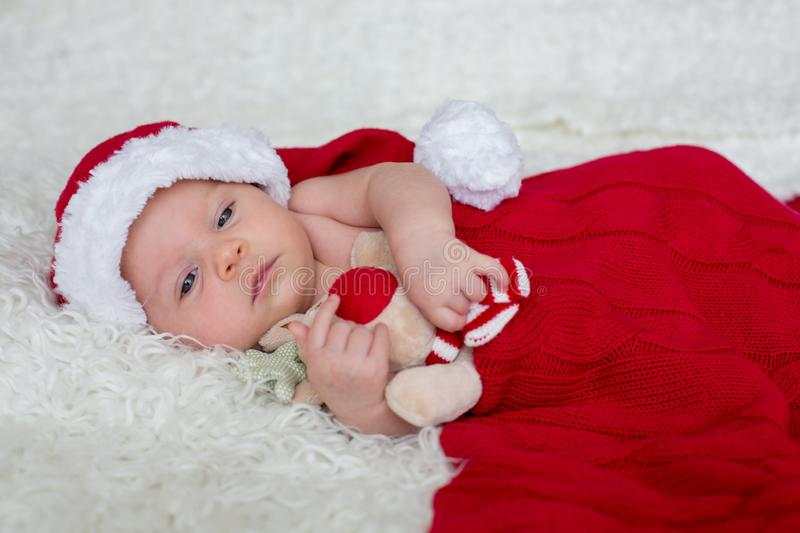 Little newborn baby boy, wearing Santa hat royalty free stock photography