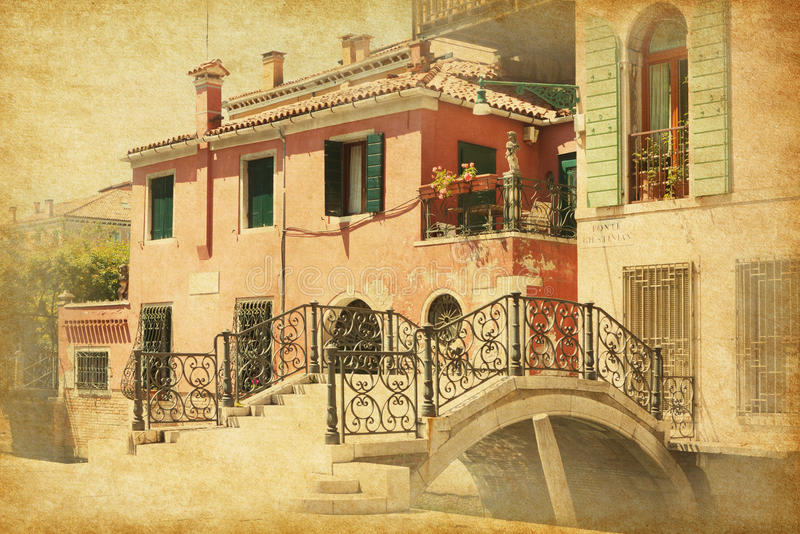 A little old bridge in Venice. Italy. Ponte Giustinian. Photo in retro style. Added paper texture stock photos