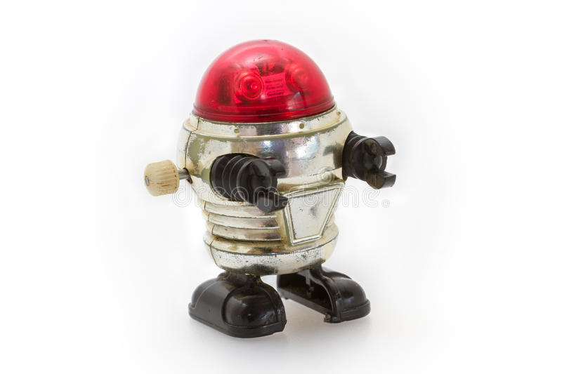 Little old toy robot. With gearwheel royalty free stock photography
