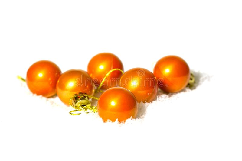 Little orange christmas balls on the snow. royalty free stock images