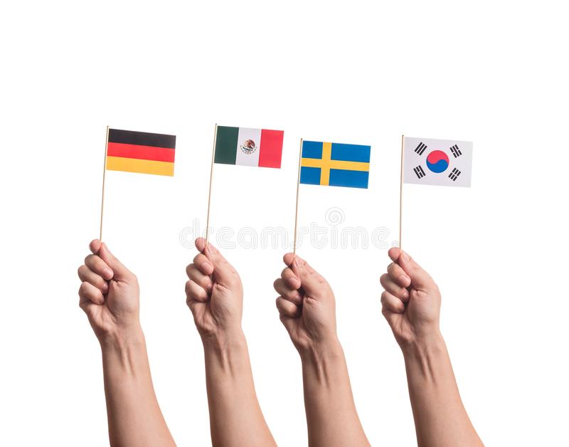 Tiny flags in hands stock photo