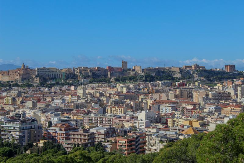 Little part of Cagliari. Sardinia, with a blue sky, some trees and the houses of the city royalty free stock photo