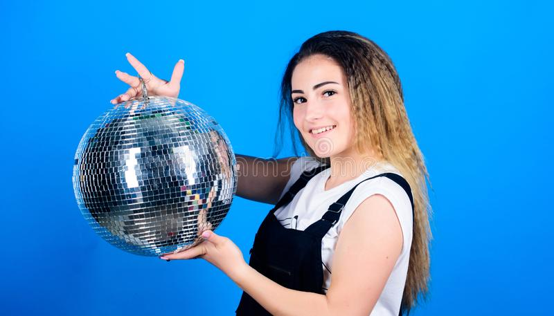 Little party never killed nobody. Dance until drop. Cheerful woman hold disco ball. Night club. Retro music. Girl. Inviting at party. Mirrors reflecting lights stock photos