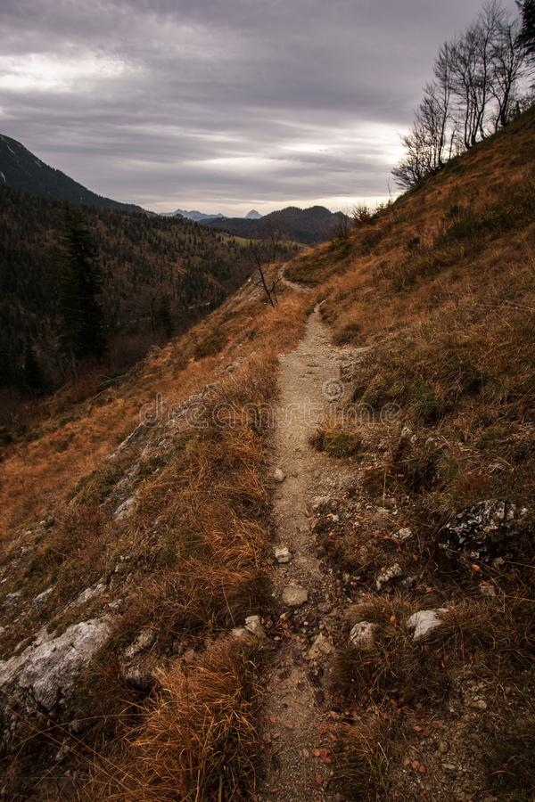 Little path leads in wide mountain landscape stock photos