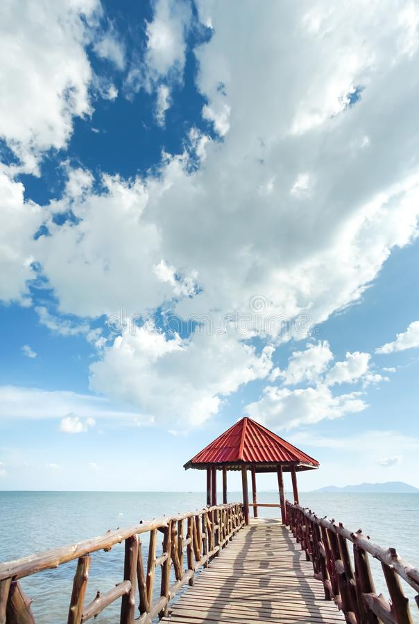 Little pavilion in the sea cloudy background stock image