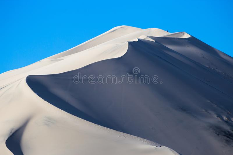 Little people on a dune royalty free stock photos
