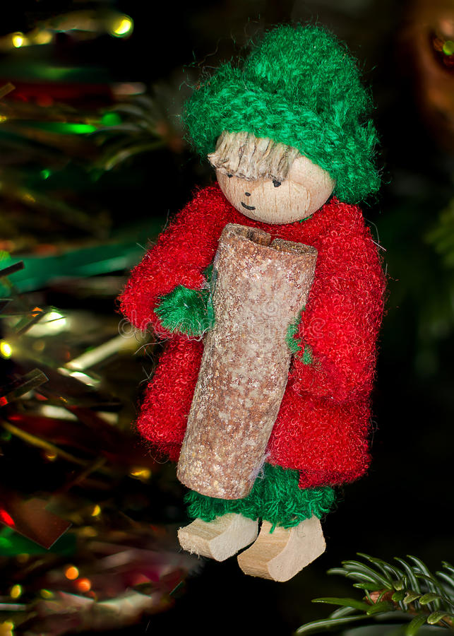 Little person of decoration of fir carrying a stick of cinnamon royalty free stock image