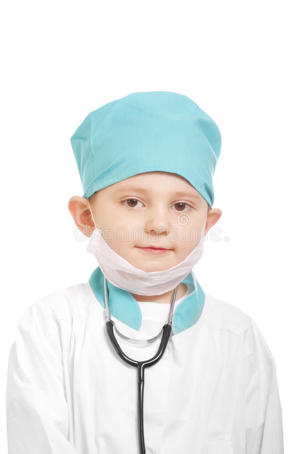 Little physician. Little kid in physician suit against white background stock photos