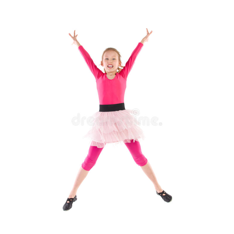 Little pink ballet dancer jumping. With arms outstretched. Full length studio shot isolated on white stock photo