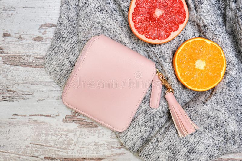 Little pink female purse, and citrus on a sweater. Fashionable c royalty free stock image