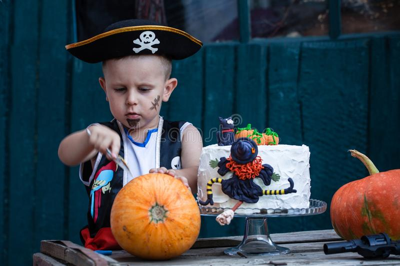 Pirate with a pumpkin and cake stock photo