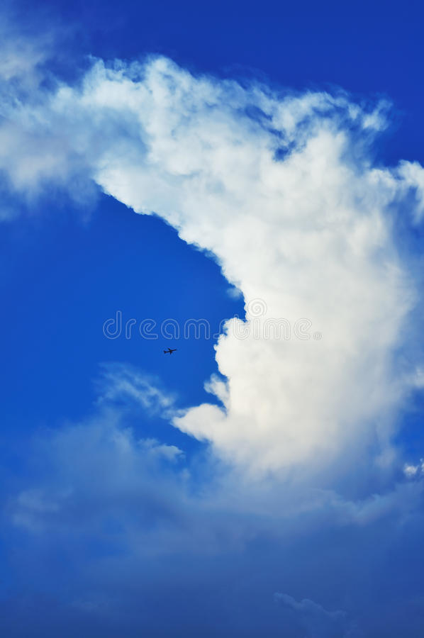 Little plane and huge clouds royalty free stock images