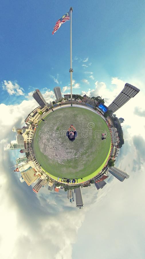 Little planet, Dataran Merdeka, Kuala Lumpur. The Sultan Abdul Samad Building is a late nineteenth century building located along Jalan Raja in front of the royalty free stock image