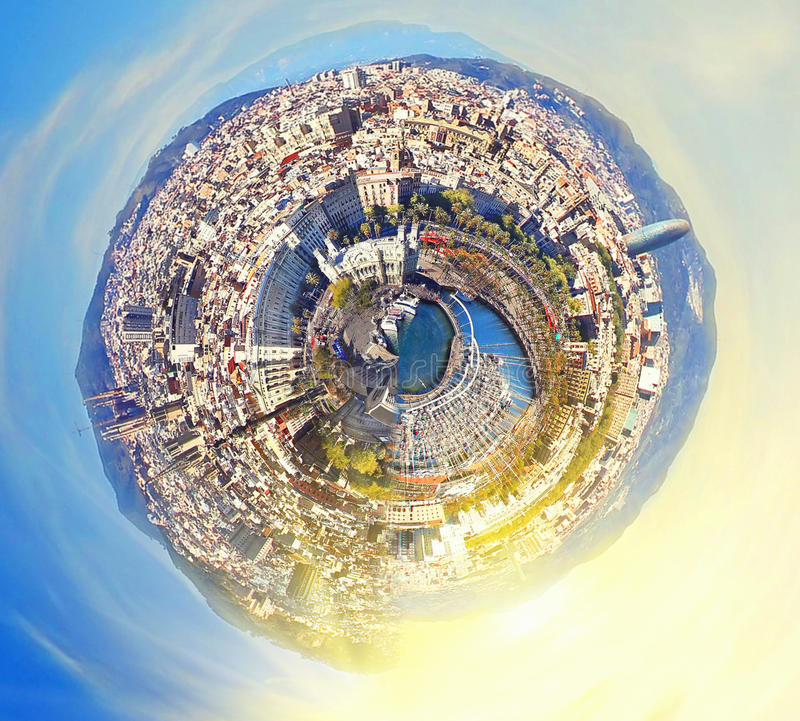 Little planet panorama of Barcelona, Spain at fantasy sunset royalty free stock photography