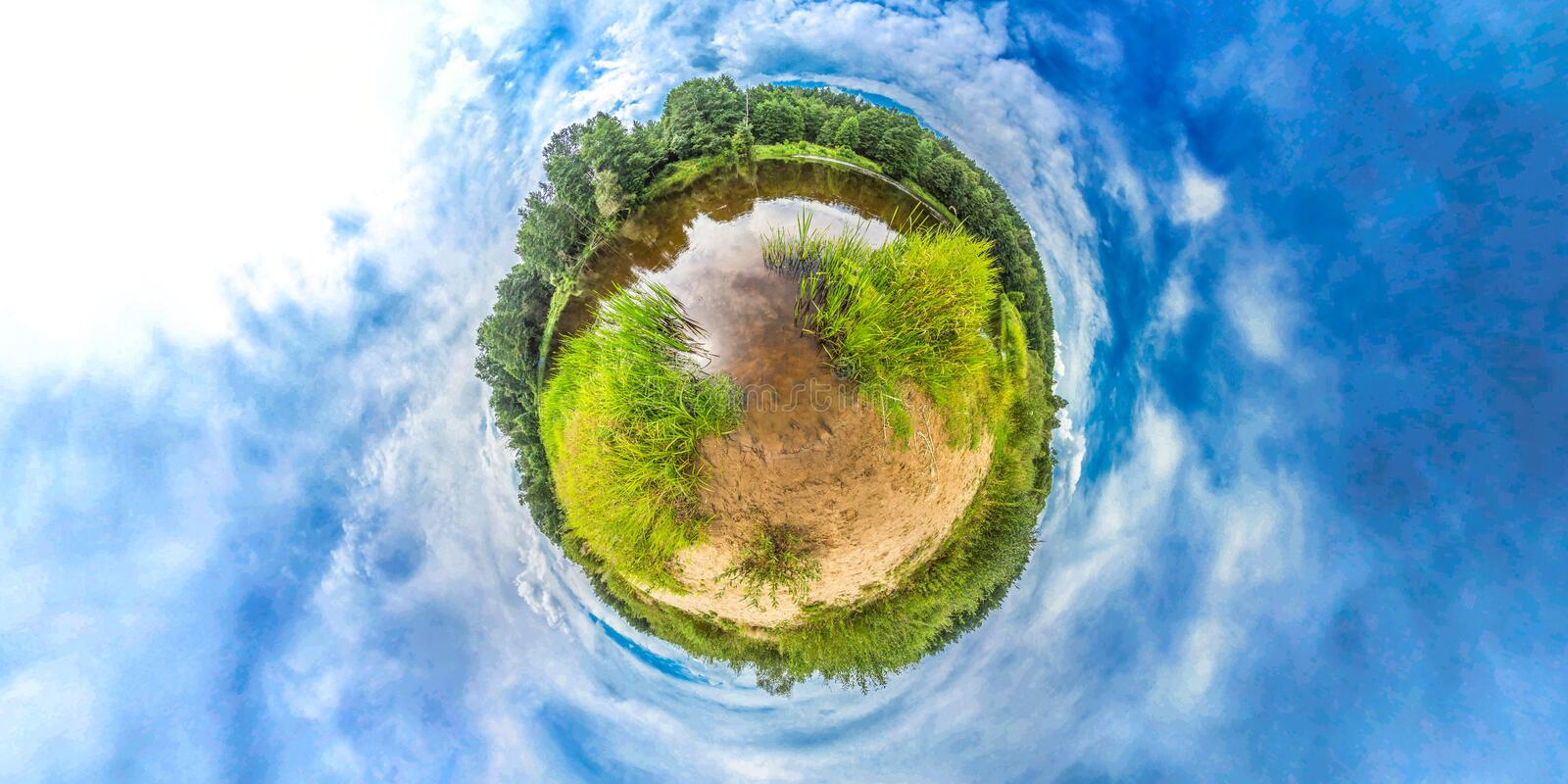 Little planet with river, forest and blue sky. Sunrise at spring. 360 royalty free stock image