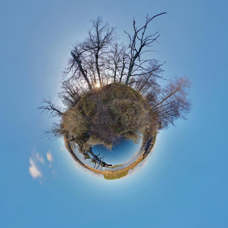 Little planet. Spherical aerial view in forest near river in nice day with nice clouds. Little planet. Spherical aerial view in a forest near river in nice day royalty free stock photography