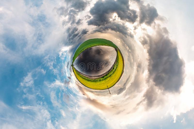 Little planet transformation of spherical panorama 360 degrees. Spherical abstract aerial view in field in nice evening with stock photography