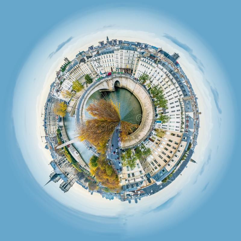 Little planet view of Panorama of Notre-dame-de-Paris and Seine river in Paris in autumn royalty free stock photo