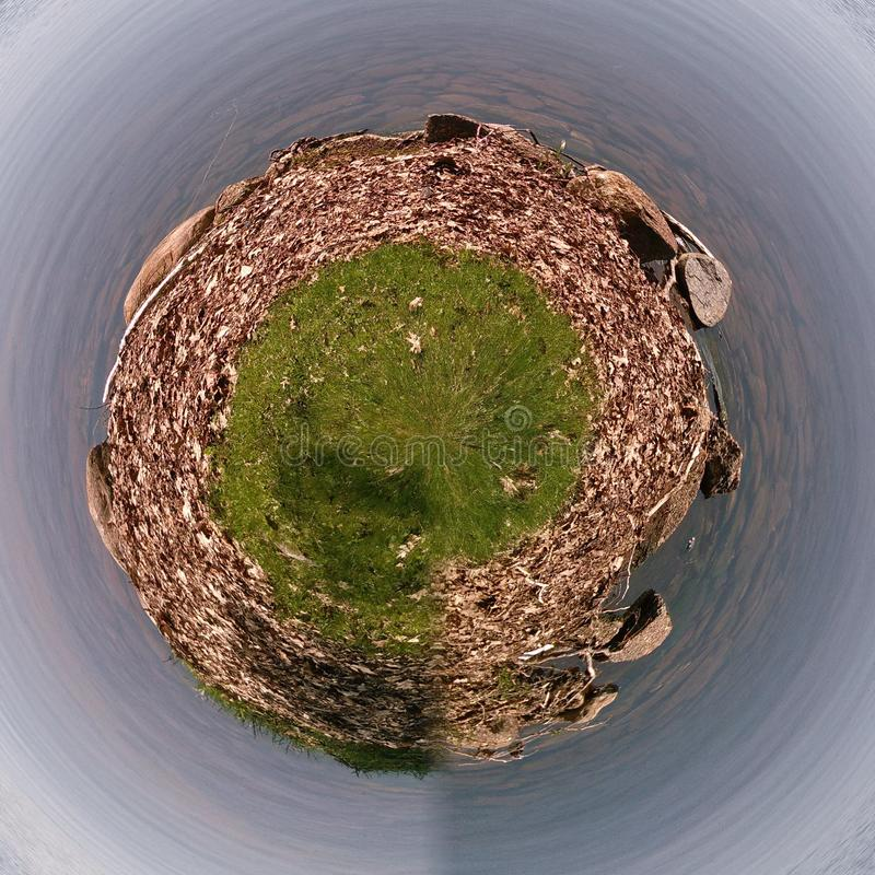 Little planet by the water royalty free stock image
