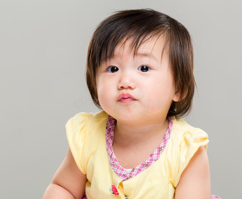 Little pouting baby girl royalty free stock images