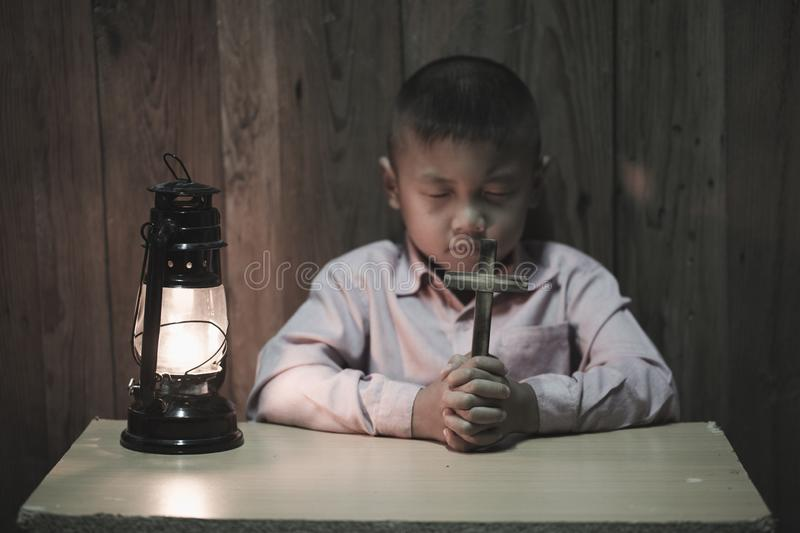 A little prayer, A boy is praying seriously and hopefully to Jesus stock photography