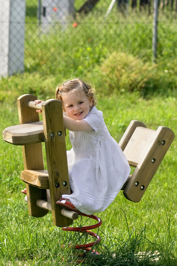 A little pretty child swinging stock photos