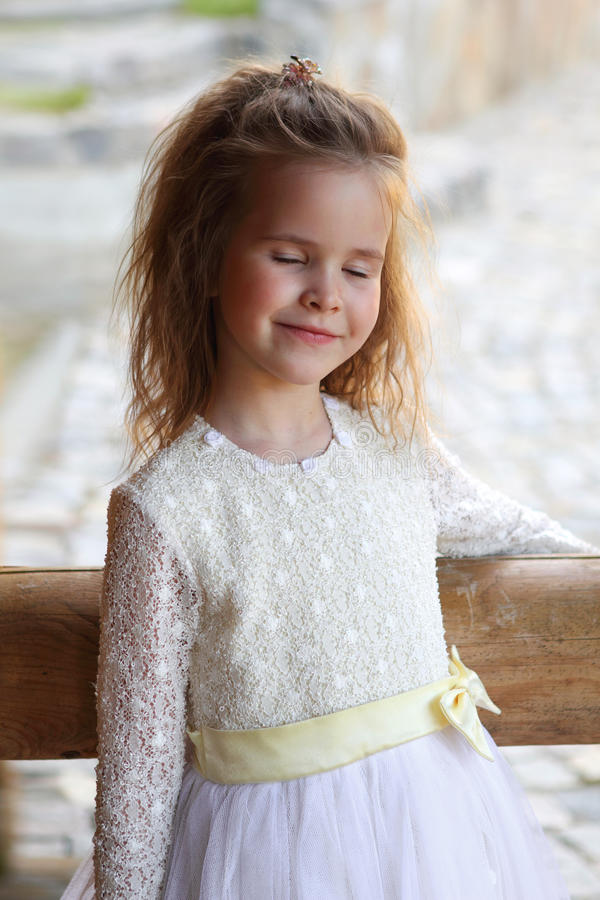 Little pretty girl dreaming royalty free stock photos